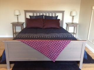 Cozy queen bed with new linens.