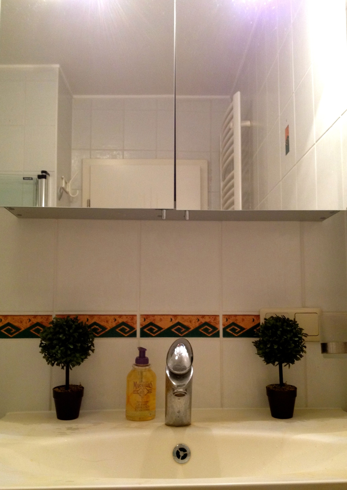 Private bathroom with separate toilet room.
