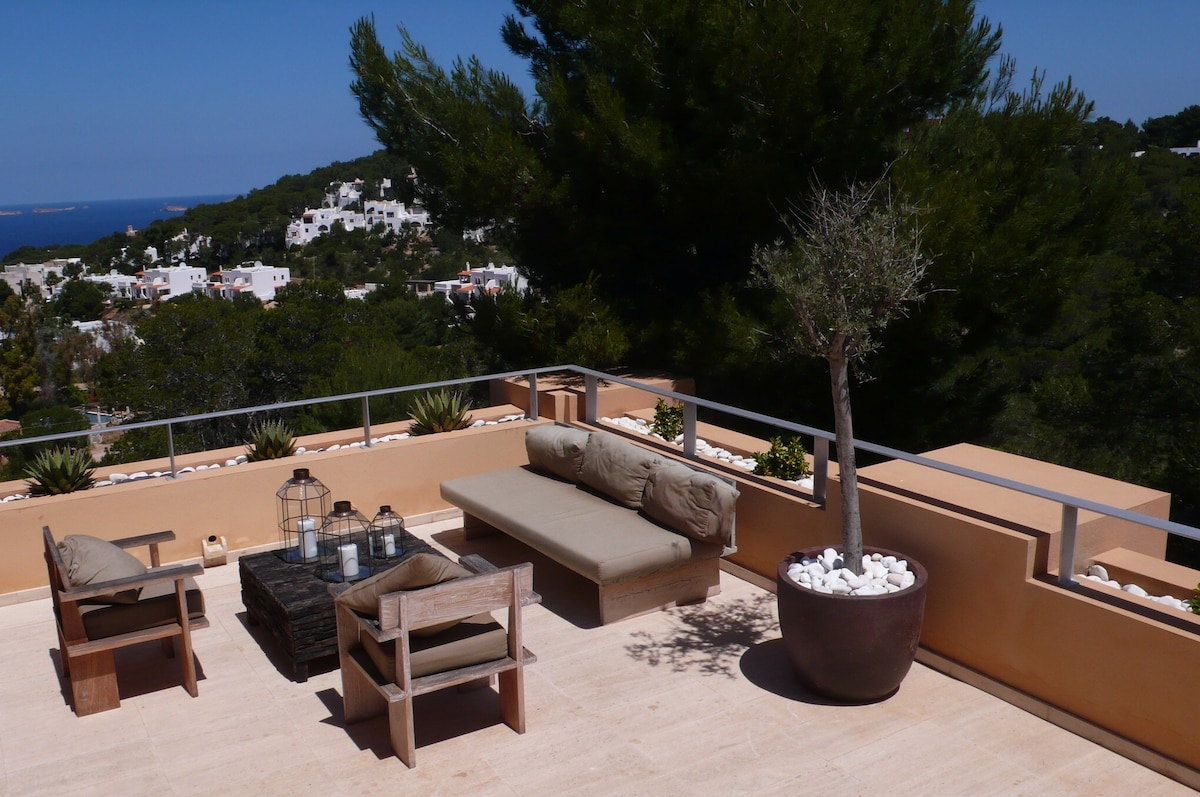 Outdoor terrace with triple aspect views of sea and surrounding countryside.