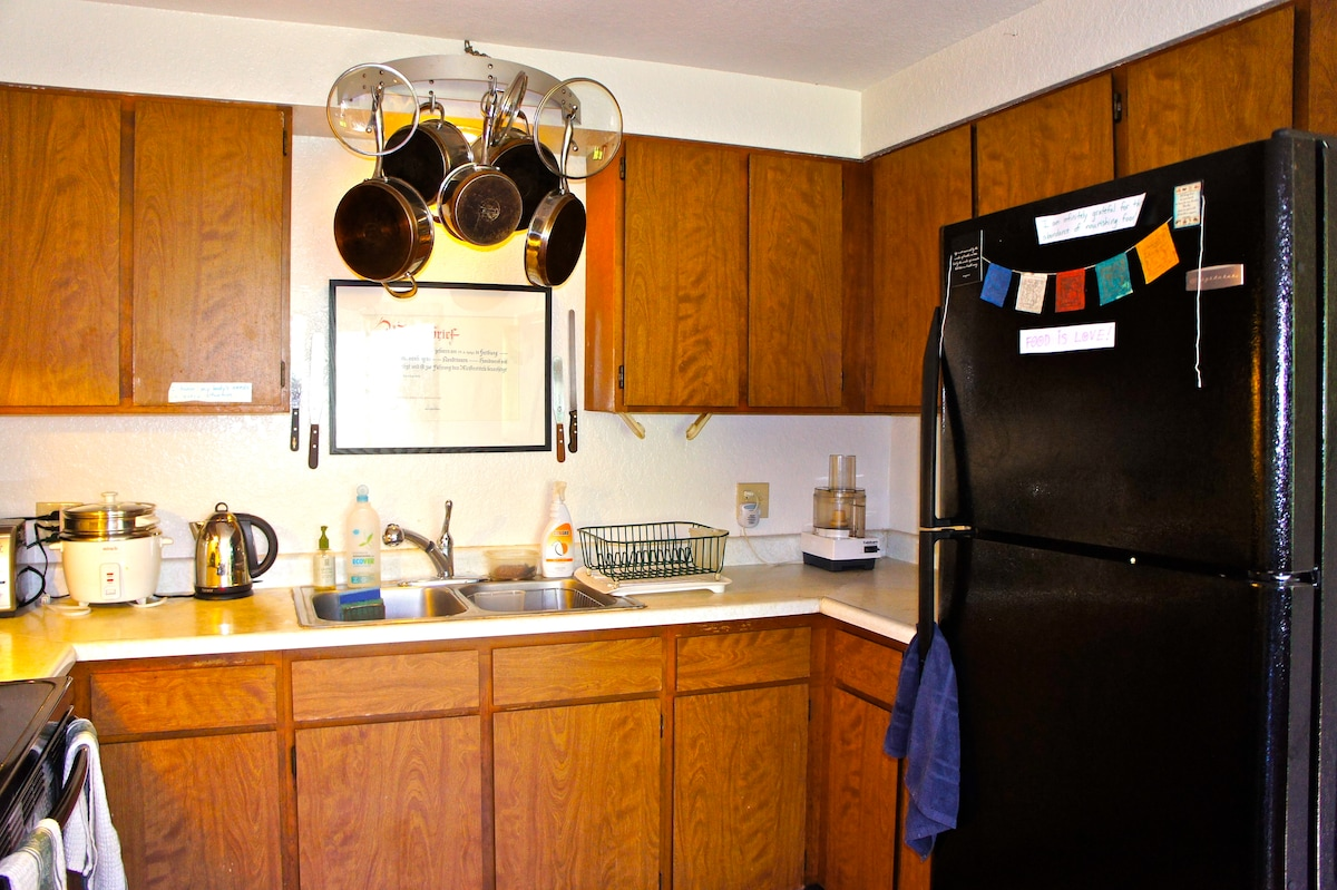 Kitchen with toaster oven, hot water kettle, stainless steel cookware