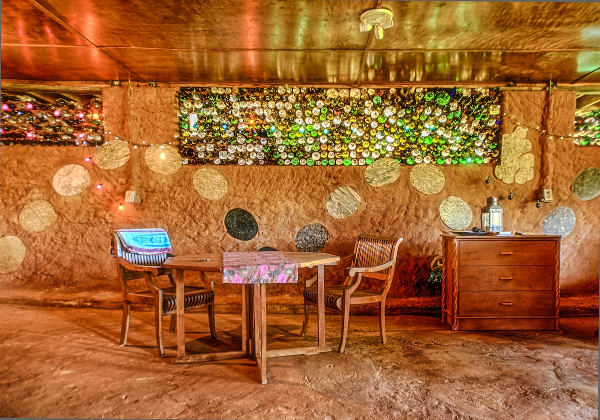 Glass bottle wall with over 1000 recycled wine bottles for windows.