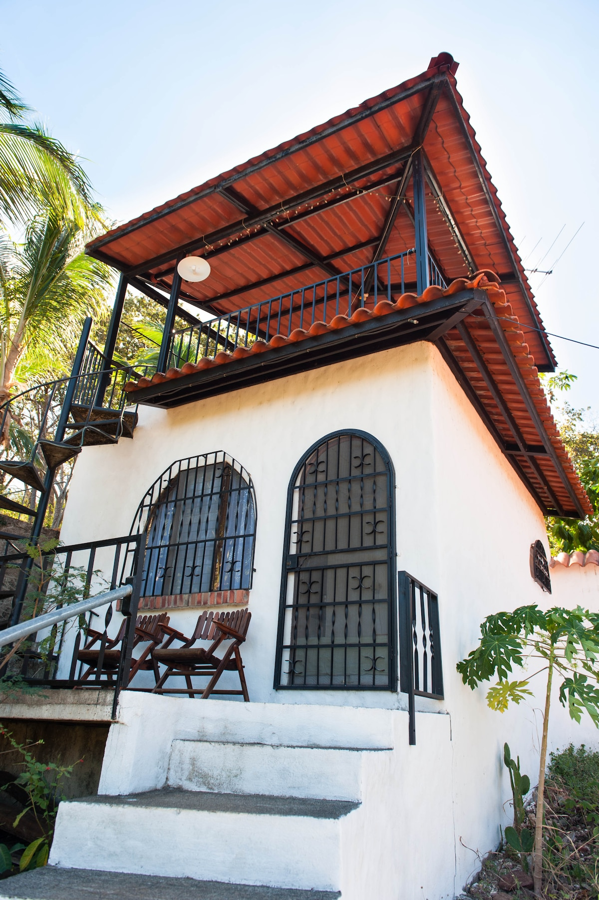Cabina with sitting area in front and private tower patio above
