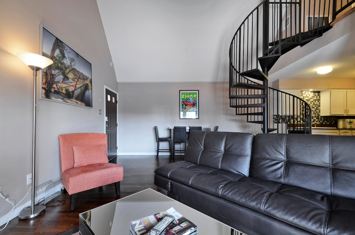 The third floor condo has vaulted ceilings.