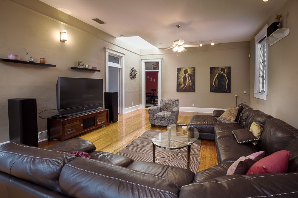 Great room with large sectional couch and 60 inch tv