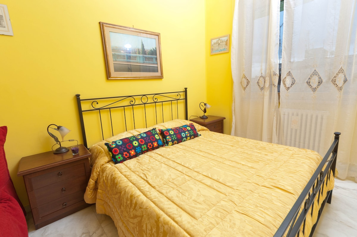 Yellow double bedroom, with queen size bed