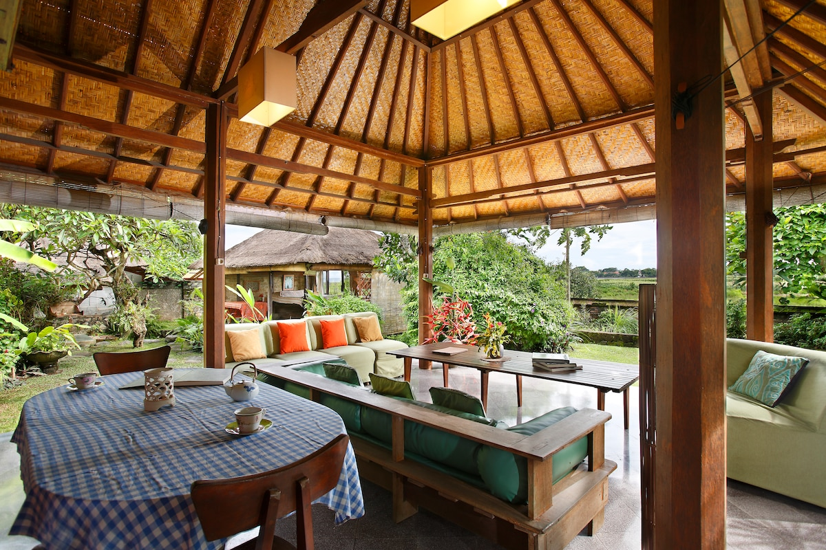 Spacious bedroom with Sanur view