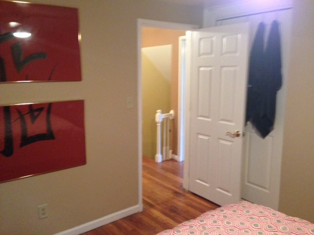 View of Entryway from the Bedroom; Condo is freshly painted throughout with original hardwood flooring.