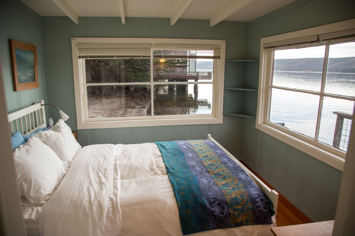 Master bedroom with wraparound water views.
