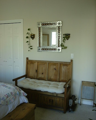 Master bedroom wall with big closet and Mexican bench with two huge drawers for storage