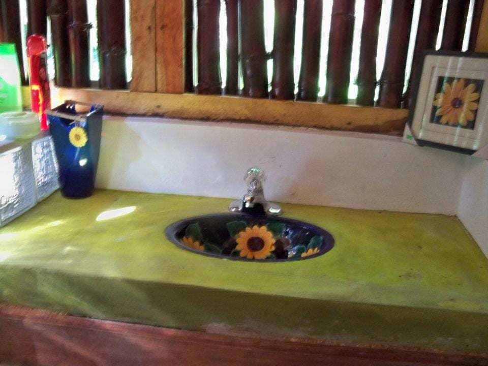 Handmade tile sink and vanity in the spring-fed shower house.
