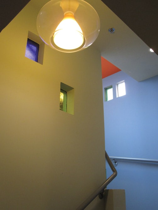 color block accents in stairwell to rooftop patio