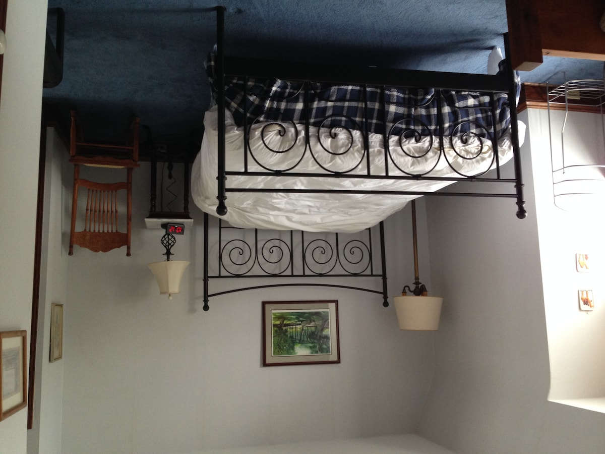 Queen bed in large  bedroom - same room has child's bed and desk.