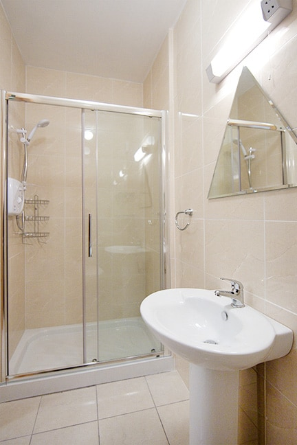 Bathroom with spacious shower and electric shower