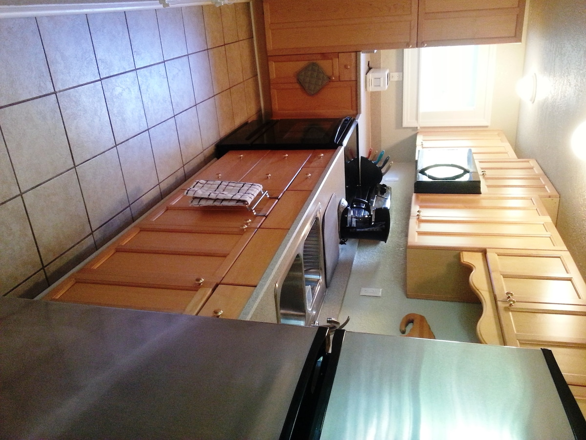 Kitchen - self-cleaning oven, microwave, and refrigerator with ice maker
