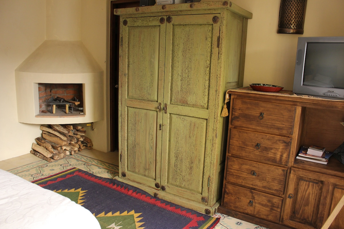 Armoire, gas/wood fireplace and tiled floors