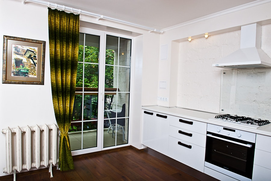 Kitchen with a door to the balcony