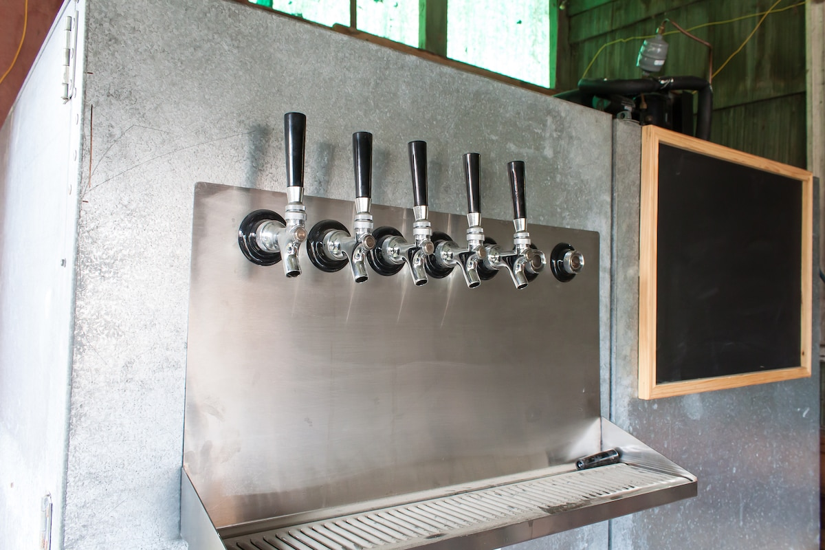 Kegarator located in the carport with 6 rotating taps.