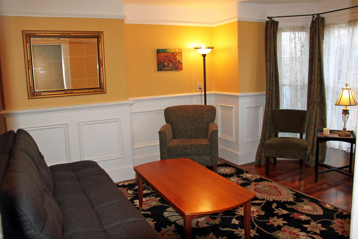 Paneled wainscoting and wood floors