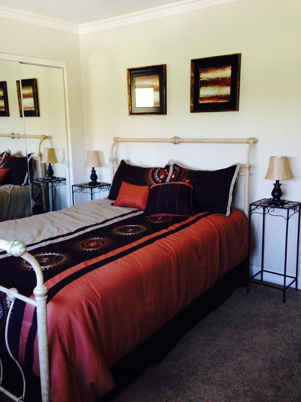 Bedroom 1, queen bed with recliner and available closet and dresser space.