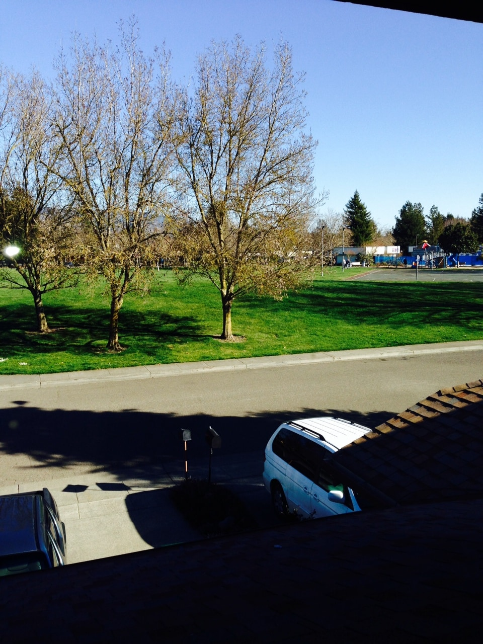 View from bedroom to the park across the street with playground and pool (seasonal)