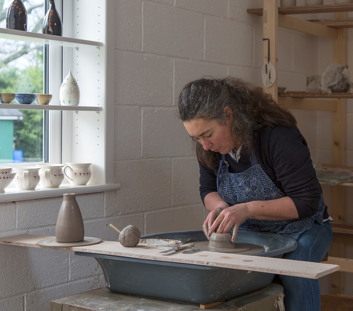 Carmen throwing at the wheel in the Pottery School.