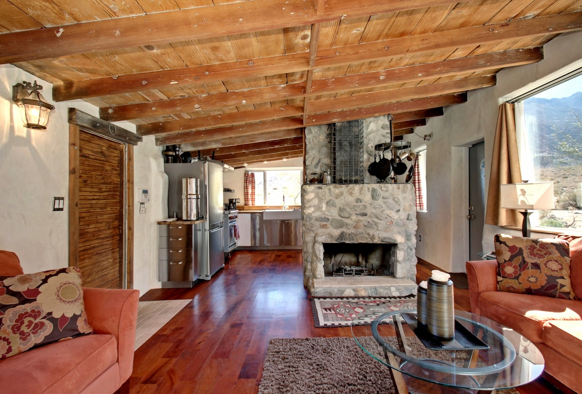Mesquite flooring and open-beam ceiling.  Living room fireplace.