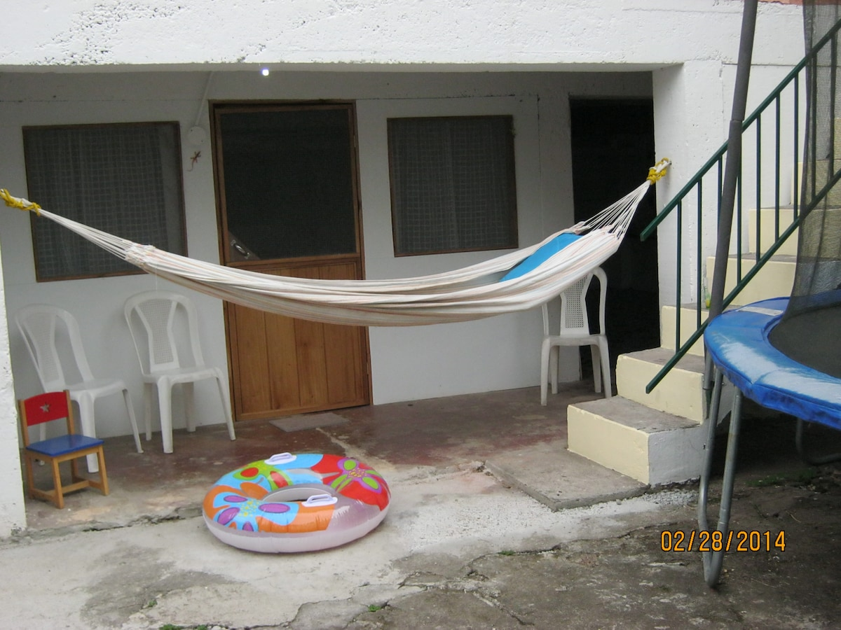 Front door of apartment. Hammock & warm sun!