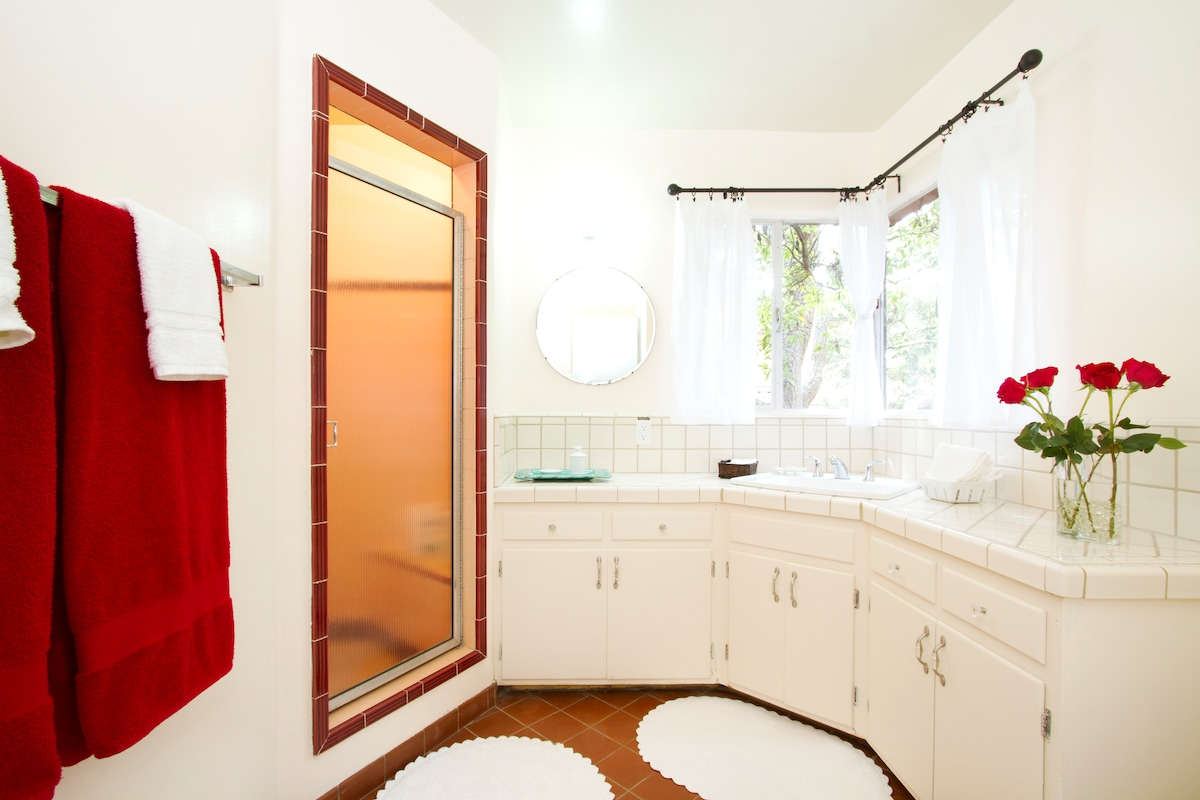 Nice spacious bathroom looks out to your private back yard.