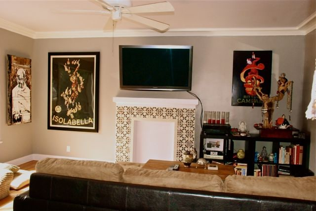 Living room with mounted 50' TV and bookshelf, art everywhere!