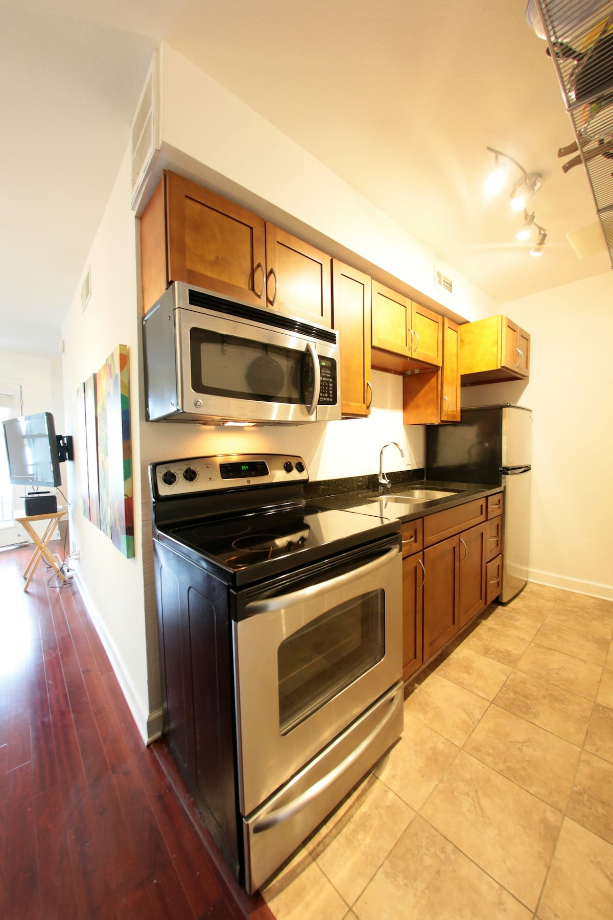 Newish appliances are all shown here and in good working order.  Tile and granite in kitchen and bathroom.