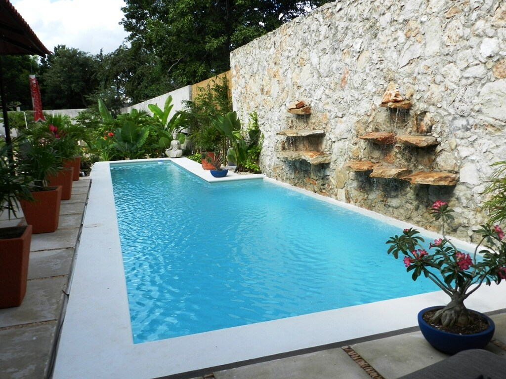 45 foot lap pool with rock waterfall