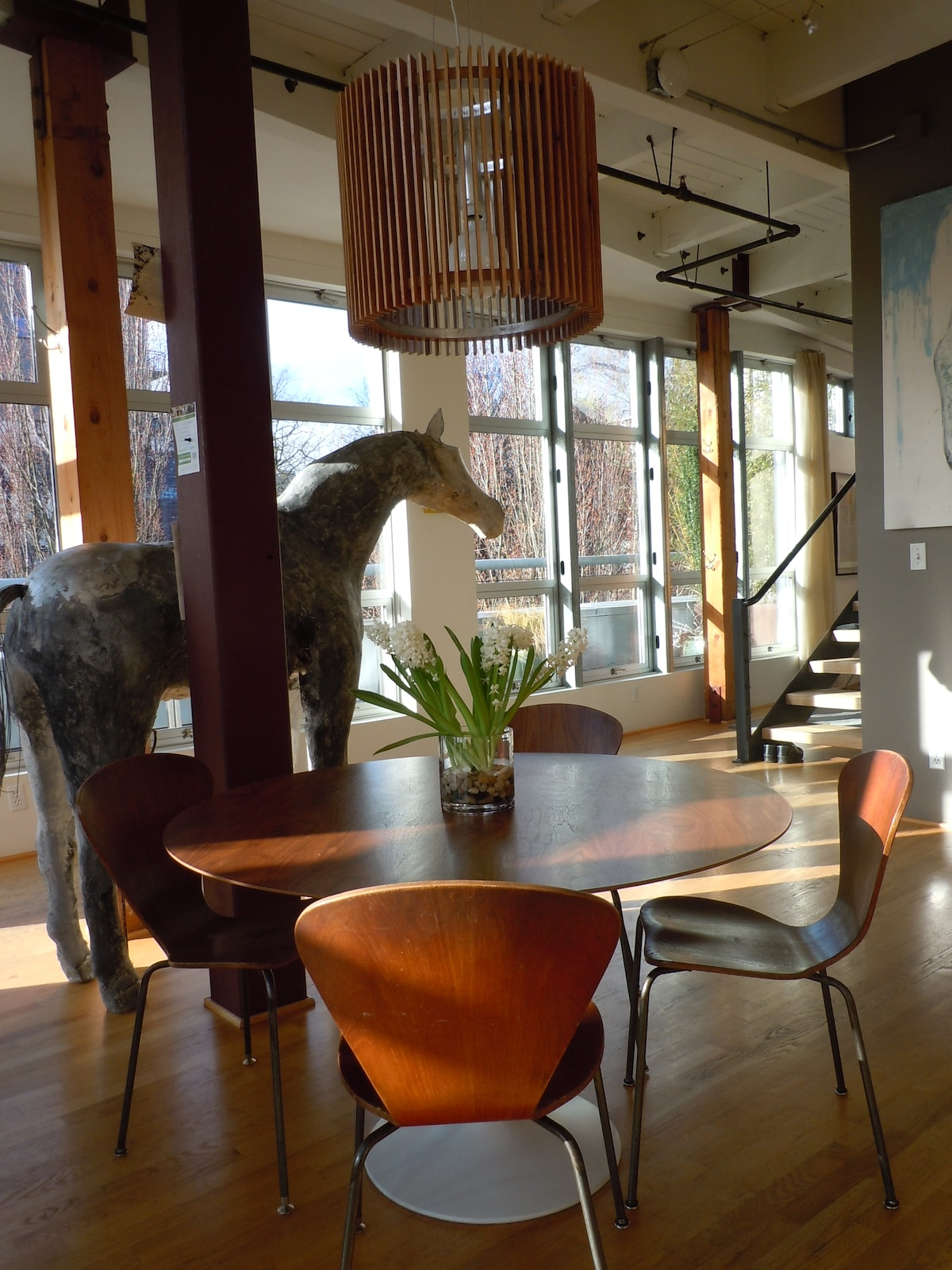 dining room with sculpture (we call him Edmond) and floor to ceiling windows