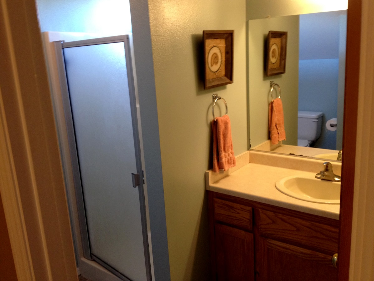 Private bathroom has a shower.