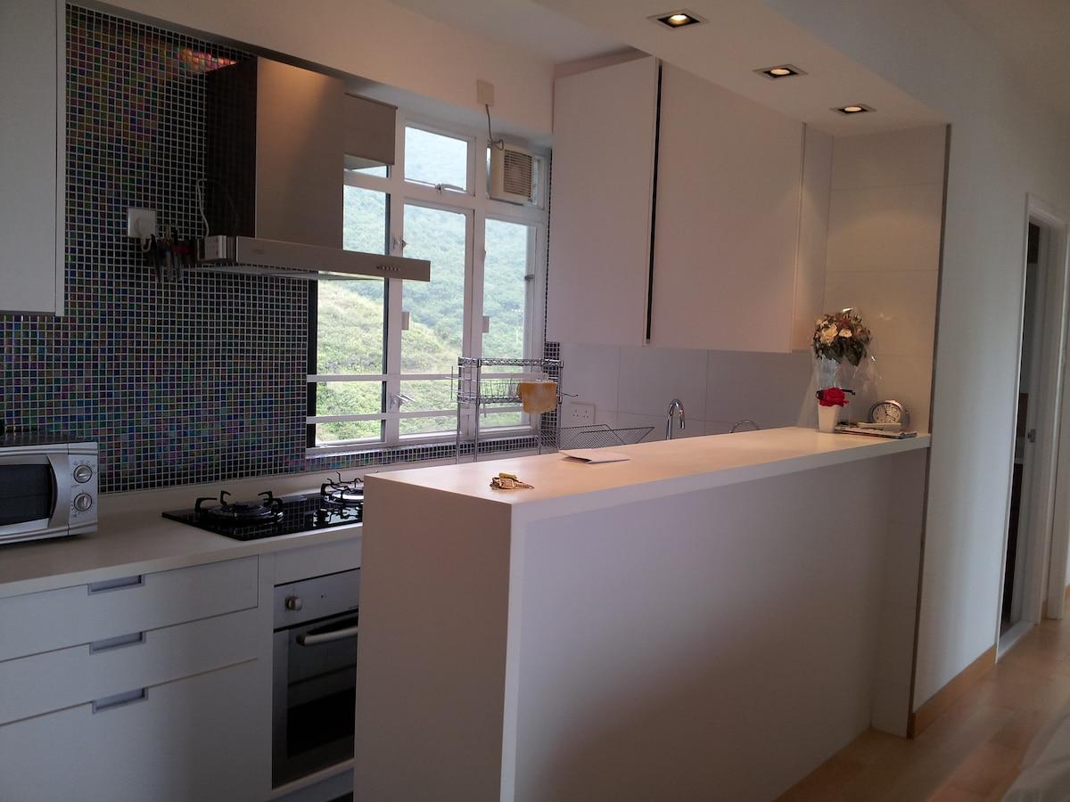 Open kitchen with full kitchenware