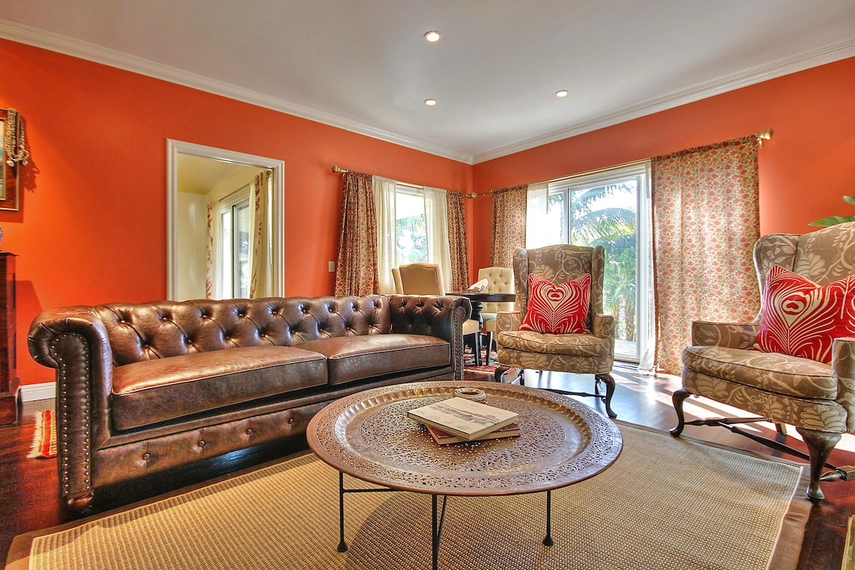 Formal living, our bright living room with luxury leather furniture, accent chairs, and wet bar.