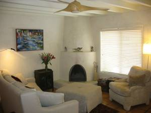 living room with kiva fireplace