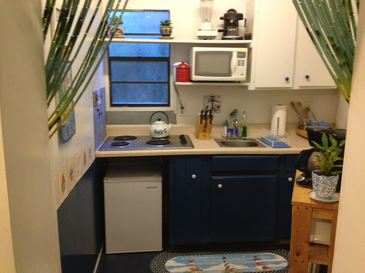 Kitchen includes, stove, toaster, coffee maker, microwave, all dishes, pots, pans, utensils, espresso machine and much more