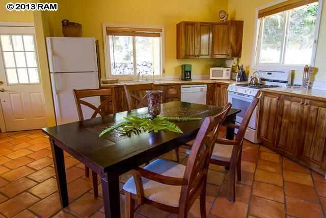 Gourmet kitchen, w/custom Koa Wood cabinets, dishwasher, stove oven and new fridge and custom dining room set.