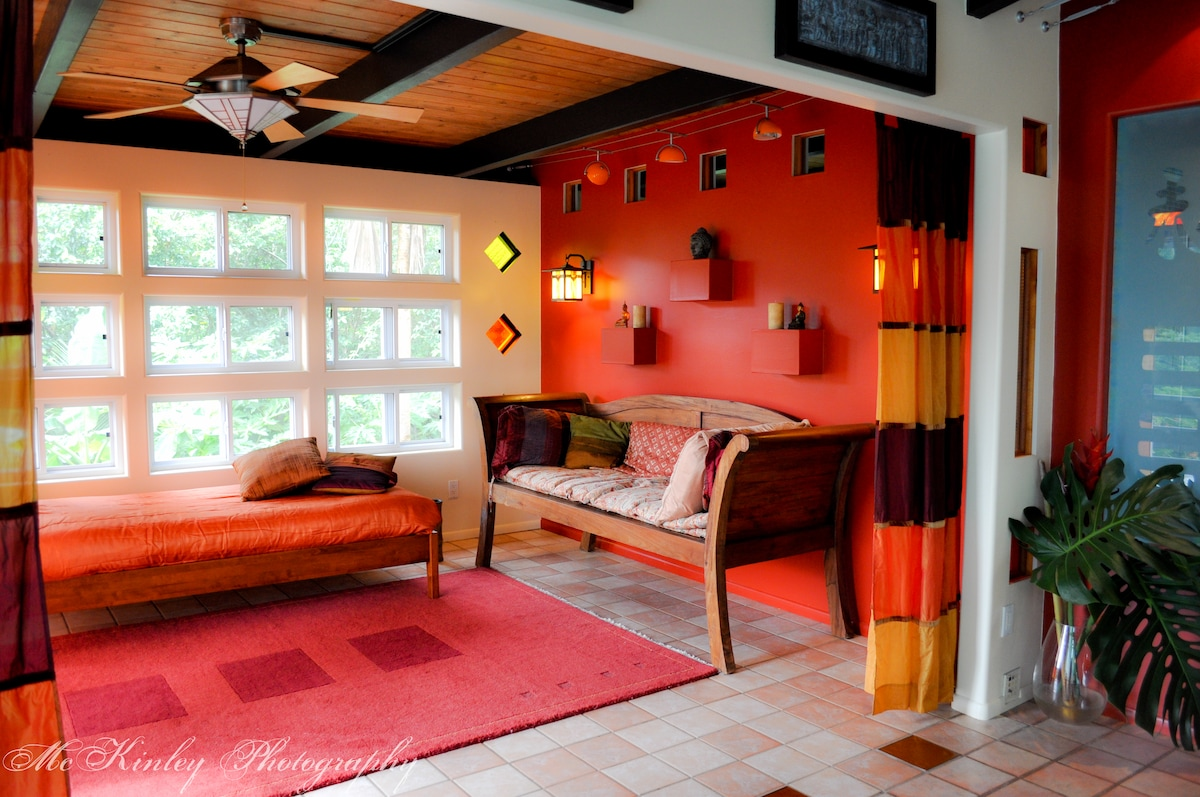 Vibrant colors exude a warmth to match the climate.  This space now includes a full bed.