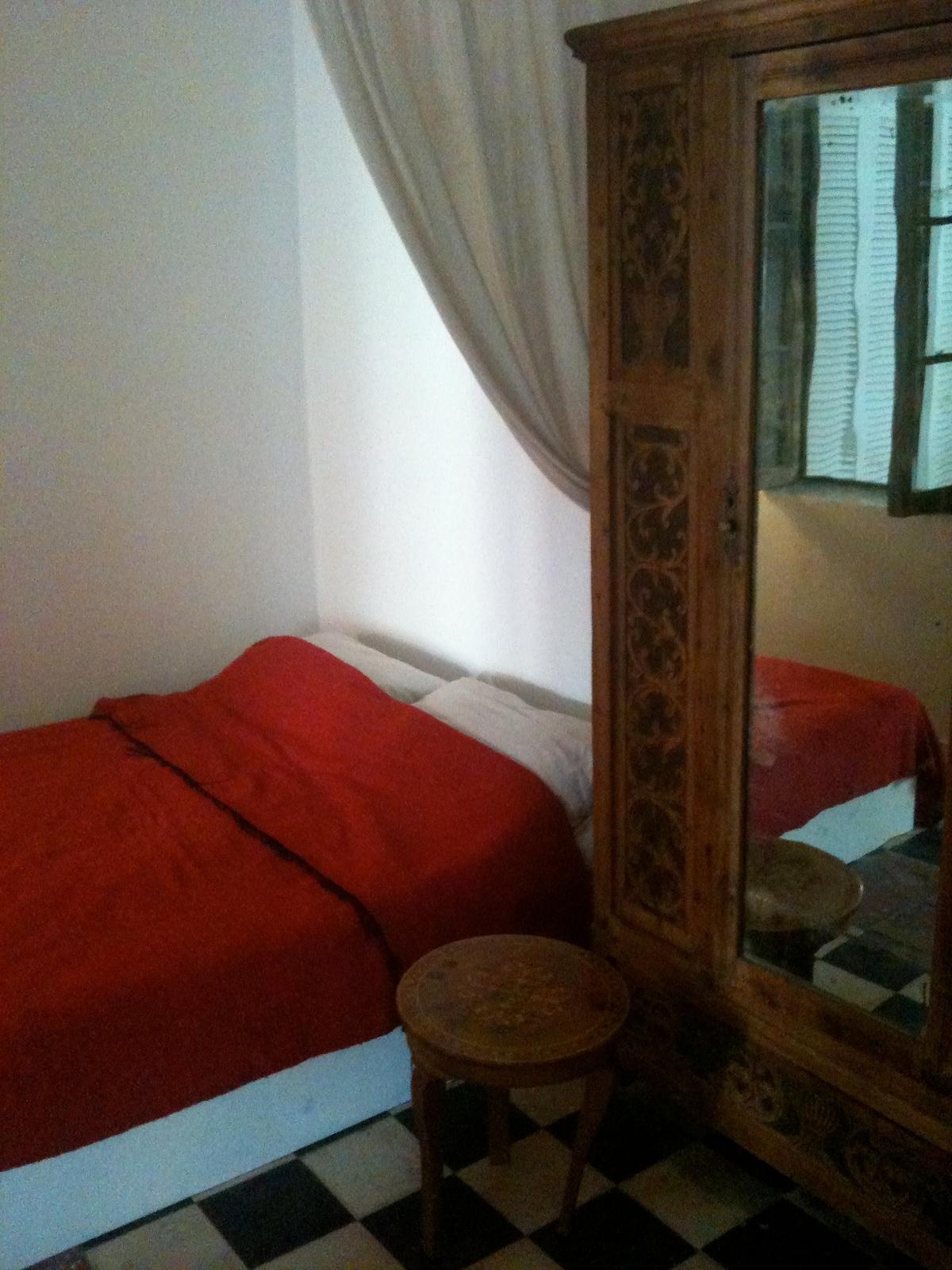 Main bedroom and vintage XVIII century thuya cupboard