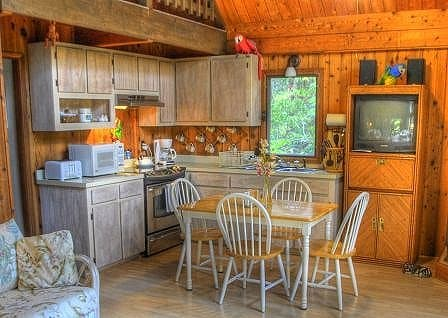 The kitchen and small dining area.  There are two stools that can be added around the table to achieve the 4 adult/2 children maximum.  The TV has been replaced with a flat screen model.