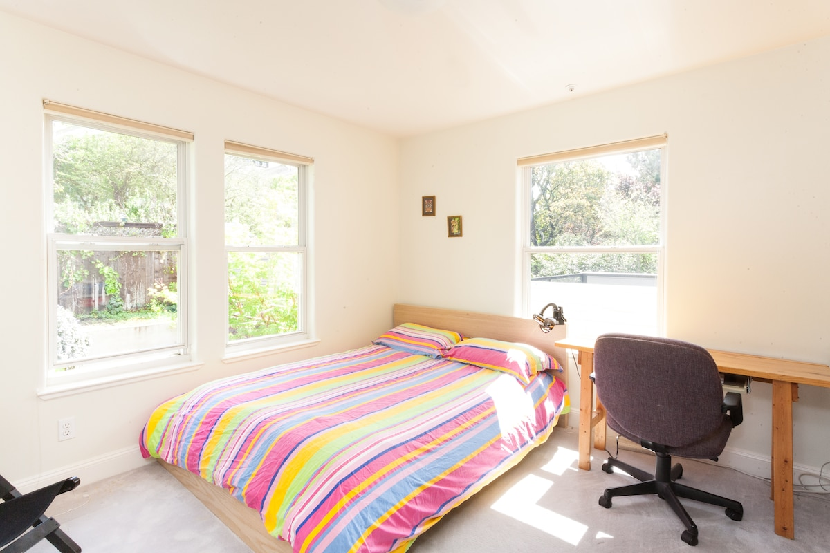 your room: queen bed, desk, lounge chair