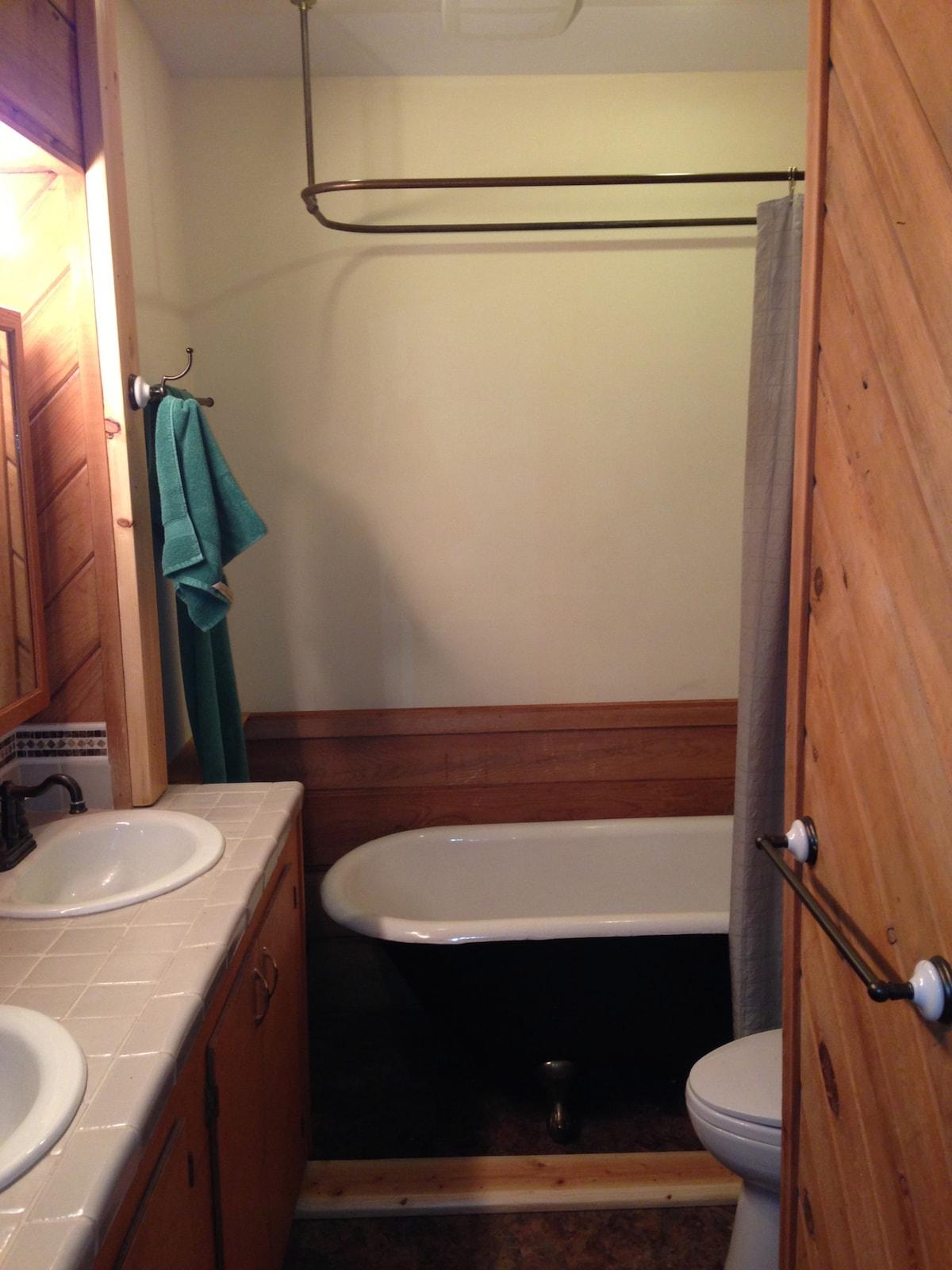 Clawfoot bathtub. Shower. Dual Sinks.