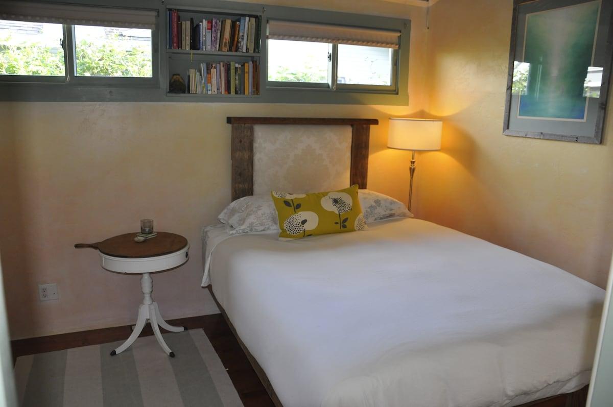 "Queen bed with organic latex mattress and handmade frame by clint - gas fireplace & 36"" flatscreen also"