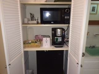 Coffee-maker, toaster, microwave and small refrigerator with freezer.