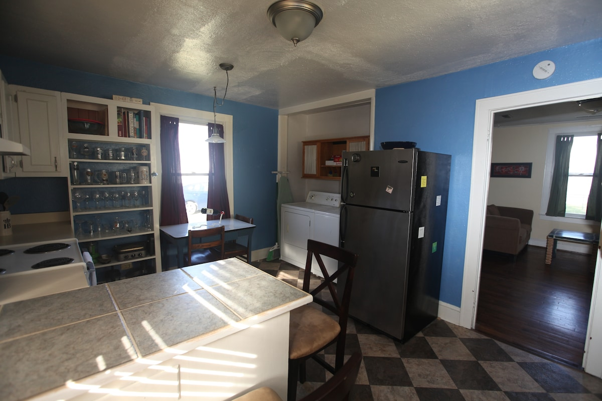 Fully stocked kitchen includes dishwasher and a laundry space with washer/dryer.