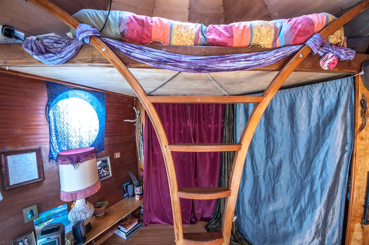 Super comfy loft space with storage space behind curtains for your clothes and suitcase