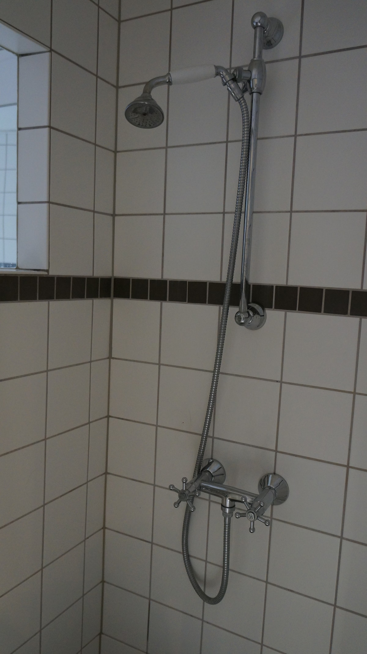 Shower section with perfect lighting and restoration in accordance with the age of the building