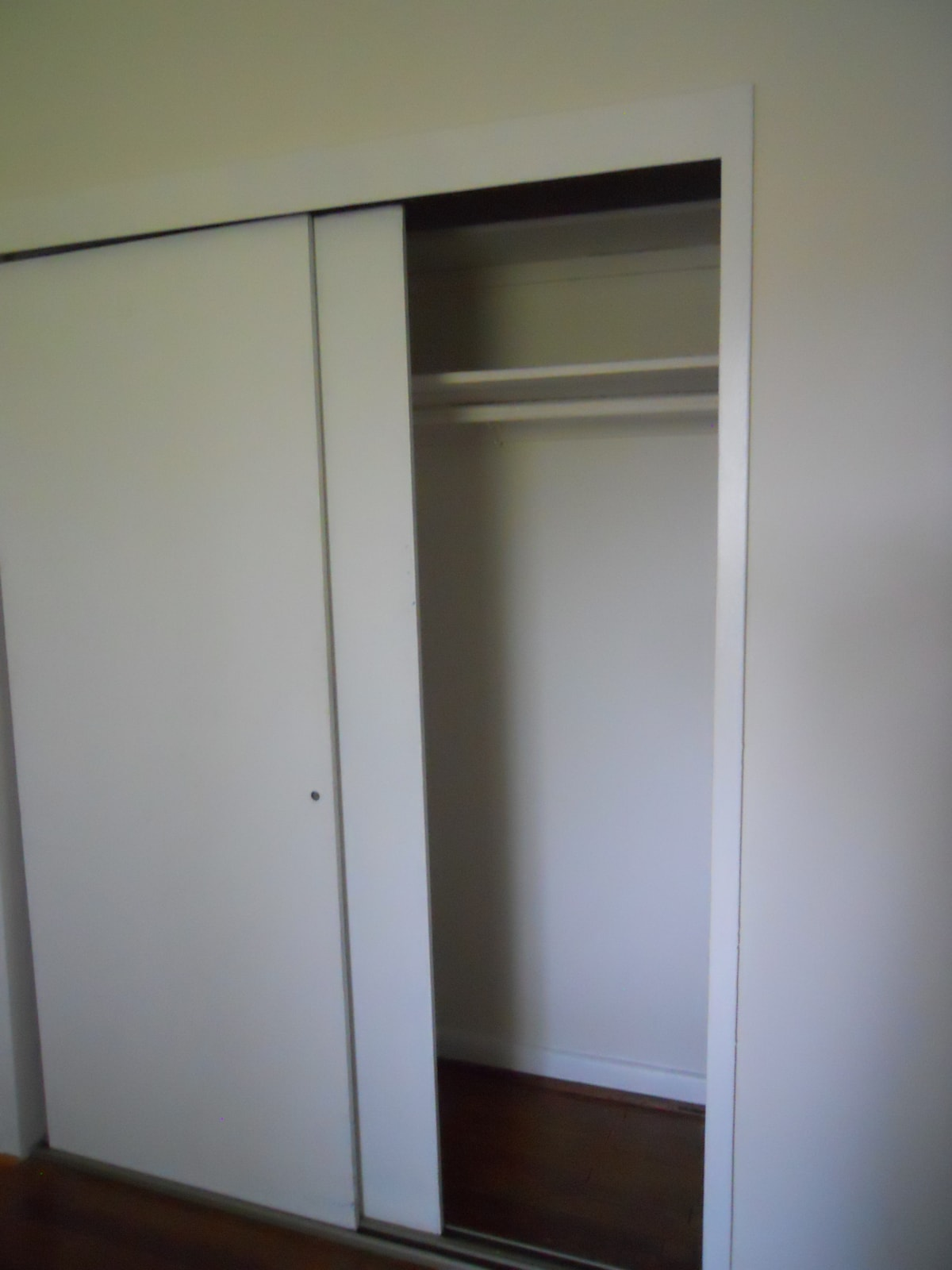 Large guest closet with your own iron and ironing board