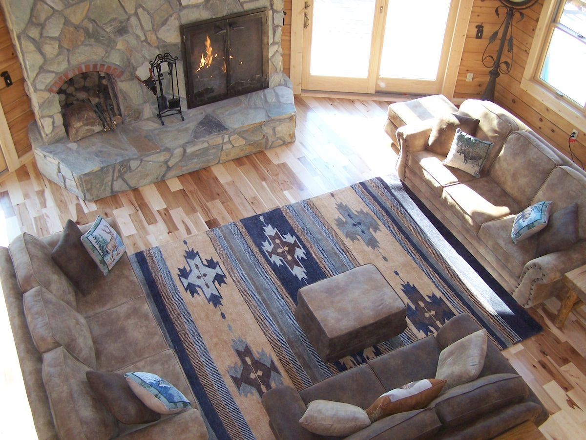 Enjoy family time in our great room while you are all cozy w/ a fire in the wood burning fireplace.  We provide FREE firewood!